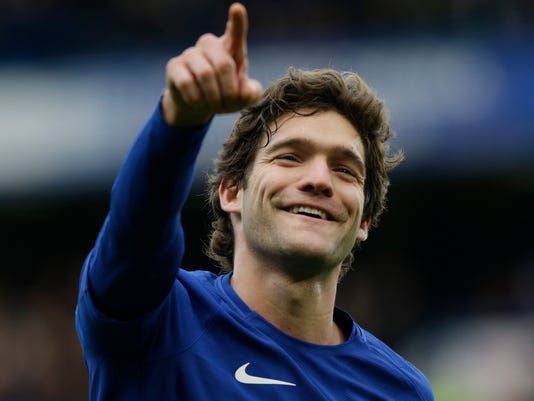 Chelsea's Marcos Alonso celebrates after scoring his side's third goal during the English FA Cup fourth round soccer match between Chelsea and Newcastle United at Stamford Bridge stadium in London, Sunday, Jan. 28, 2018 . (AP Photo/Alastair Grant)