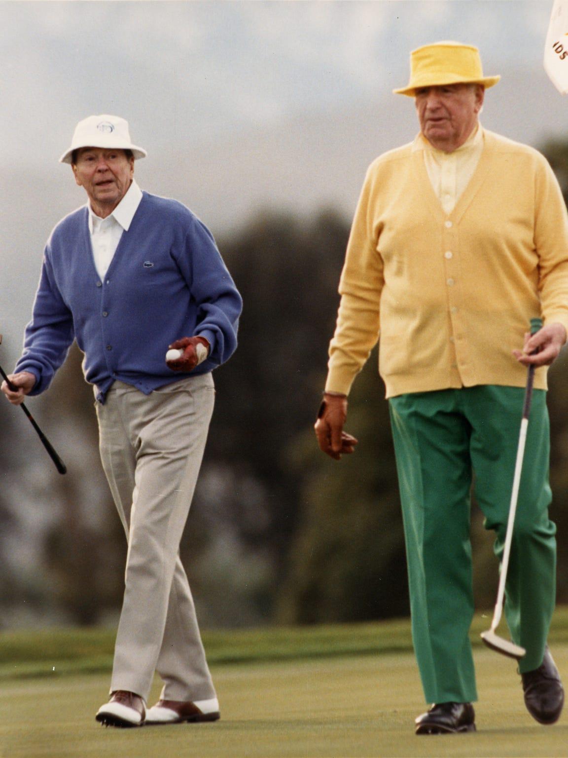 President Ronald Reagan golfs with Walter Annenberg