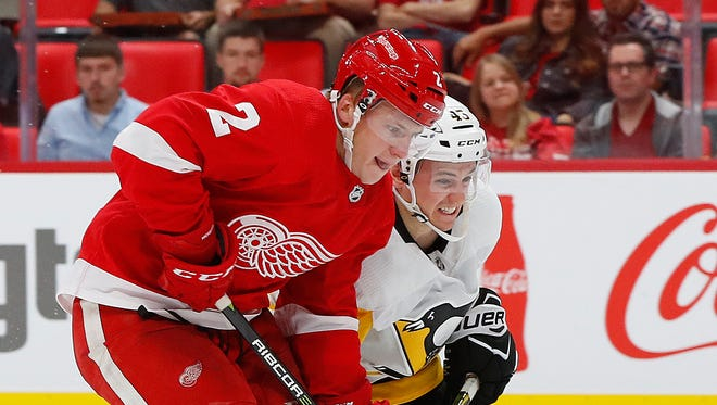 Red Wings' Joe Hicketts and Penguins ' Conor Sheary race for the puck in the third period Sept. 25, 2017 in Detroit.