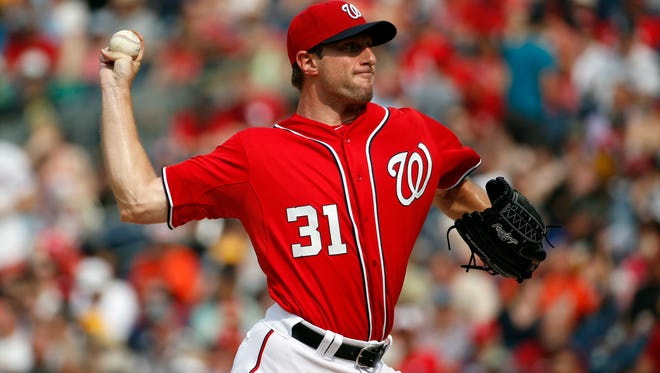 Washington Nationals starting pitcher Max Scherzer (31) throws during the third inning of a baseball game against the Pittsburgh Pirates, Saturday, June 20, 2015, in Washington.