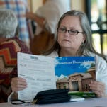 Jayne Baker looks over the amenities of the 2016 American Dream Home during the Parade of Homes Kick Off Event and Outstanding Home Awards ceremony at the Corrine-Jones Sanders Beach Community Center Thursday May 5, 2016.