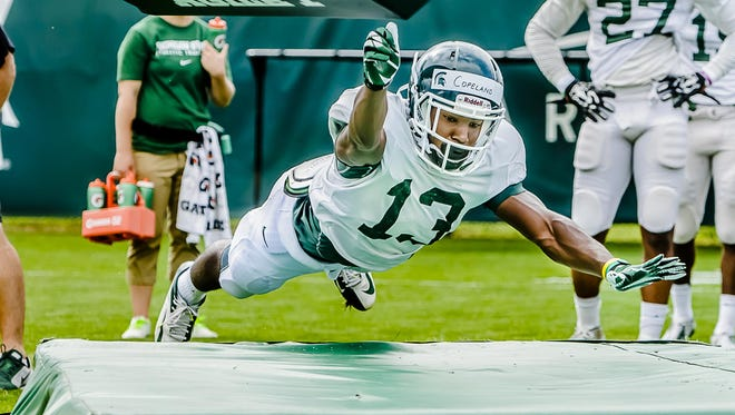 MSU cornerback Vayante Copeland heads for a mat after going low on a dummy in a tackling drill during a summer camp practice Wednesday August 6, 2014 at the Duffy Daugherty Building in East Lansing. KEVIN W. FOWLER PHOTO