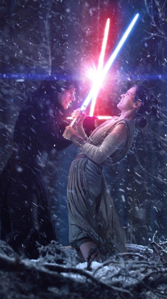 Kylo Ren (Adam Driver, left) and Rey (Daisy Ridley)