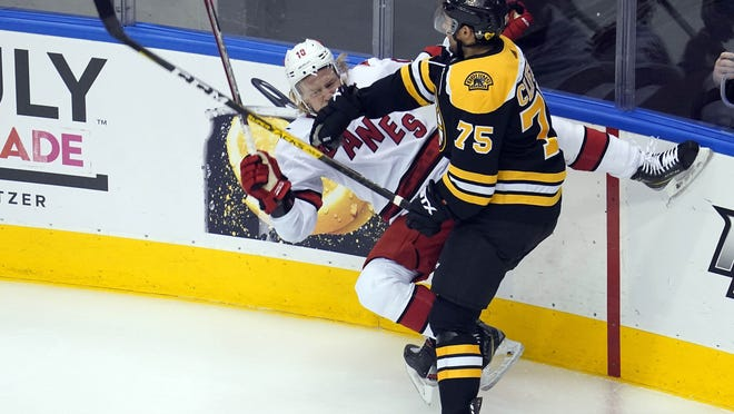 Boston Bruins defenseman Connor Clifton (75) hits Carolina Hurricanes center Ryan Dzingel (18) during the first period in game five of the first round of the 2020 Stanley Cup Playoffs at Scotiabank Arena on Aug. 19, 2020.