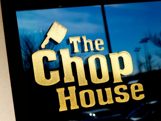 "A sign of ""The Chop Shop"" restaurant is featured on"