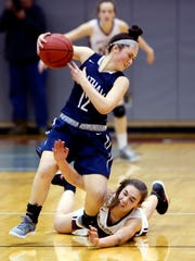 Morristown's Elizabeth Strambi dives for the ball controlled