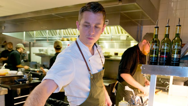 Chef Alex McPhail serves up his dishes at Restaurant Iron in downtown Pensacola