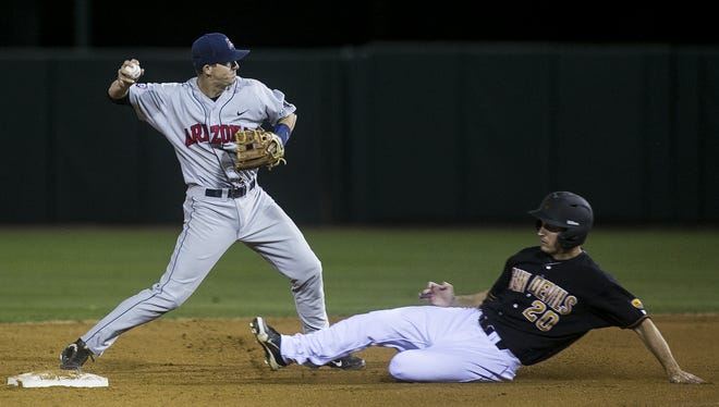 U of A shortstop Kevin Newman tags out ASU senior right fielder Trever Allen at an ASU home game against the University of Arizona April 11, 2015 at Phoenix Municipal Stadium in Tempe, Arizona.