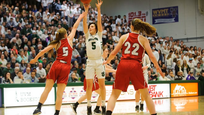 St. Johnsbury's Sadie Stetson (5) shoots the ball during the Vermont high school girls division I basketball championship between the St. Johnsbury Hilltoppers and the Champlain Valley Union Redhawks at Patrick Gym on Sunday afternoon March 11, 2018 in Burlington.