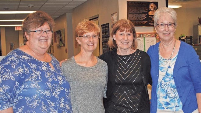 Four retiring Williamsburg Community School District teachers were recognized for their service to the district at the May 11 board of education meeting. Pictured are, from left, Pam Newberry, 38 years, first grade; Deb Henderson, 36 years, kindergarten, first and second grades; Karen Thimmesch, 28 years, at-risk/Title 1, and Carolyn Detweiler, 17 years, media specialist.