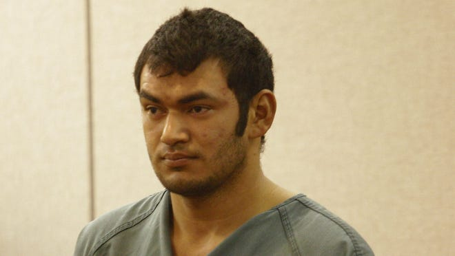 Carlos I. Menjivar, 22, appears in a Freehold courtroom to face murder charges in a 2013 Long Branch double slaying.