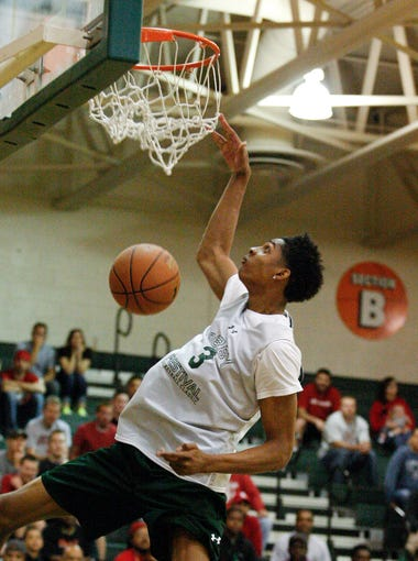 Devin Robinson, #3, skies in for a dunk during the Derby Festival Basketball Classic dunk contest at the Floyd Central High School.  Robinson was one of three dunk finalists who will compete during the Classic. Apr. 17, 2014