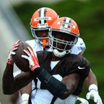Cleveland Browns wide receiver Nate Burleson (13) catch the ball for a touchdown during training camp at InfoCision StadiumÐSumma Field.