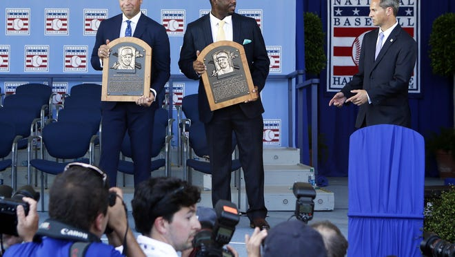 National Baseball Hall of Fame inductees Mike Piazza, left, and Ken Griffey Jr. hold their plaques for photos after the induction ceremony at Clark Sports Center on Sunday, July 24, 2016, in Cooperstown, N.Y. (AP Photo/Mike Groll)