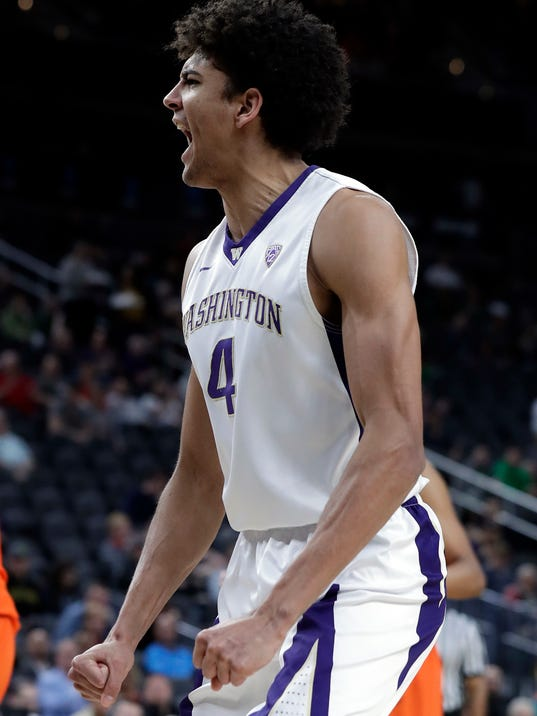 Washington's Matisse Thybulle reacts after scoring during the first half of an NCAA college basketball game against Oregon State in the first round of the Pac-12 men's tournament Wednesday, March 7, 2018, in Las Vegas. (AP Photo/Isaac Brekken)