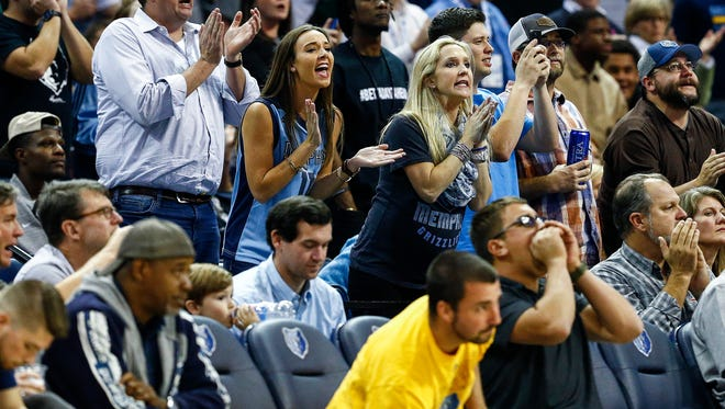 Grizzlies fans cheer during action against the Dallas Mavericks on Thursday at FedExForum.