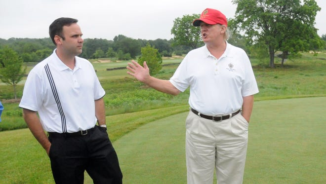 Donald Trump, right, speaks with Dan Scavino, during a June 13, 2010 visit to Trump National Golf Club, Hudson Valley, in Stormville.