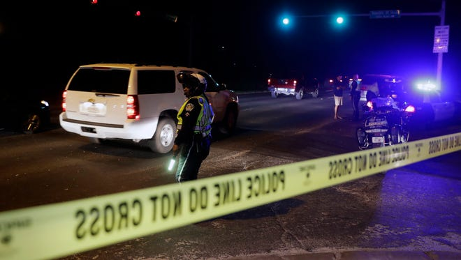 Police continue to restrict access to the neighborhood at the site of Sunday's explosion, early Monday, March 19, 2018, in Austin, Texas.