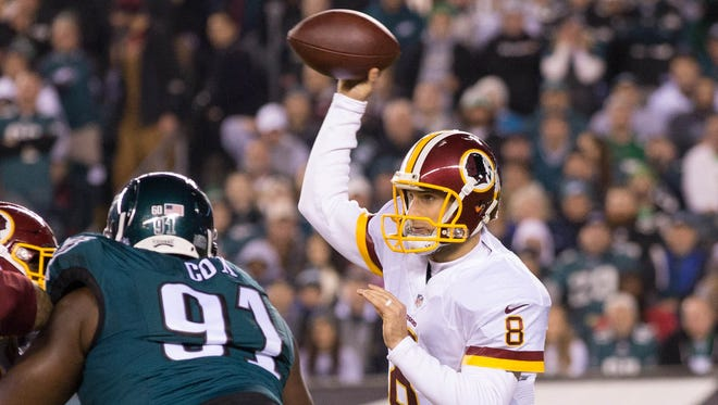 Washington Redskins quarterback Kirk Cousins (8) passes against the Philadelphia Eagles during the first quarter at Lincoln Financial Field.
