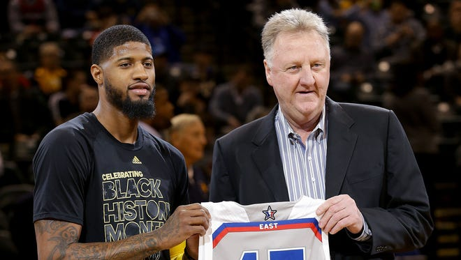 Indiana Pacers president Larry Bird presented Paul George (13) his 2017 NBA All-Star jersey before the start of their game against the Washington WizardsThursday, February 16, 2017, evening at at Bankers Life Fieldhouse.