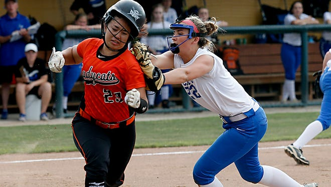 Williamsburg first baseman Paige Fisher tags out North Union batter Madison Amstutz during their Division III regional softball final at Wright State in Fairborn Saturday, May 26, 2018. E.L. Hubbard for the Enquirer