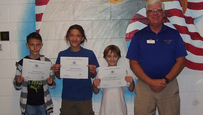 The September Most Improved Alamogordo Kiwanis Club Holloman Middle School students are pictured from left to right: Dominic McCaslin, Christian Mezzeroba, Harley Meyer and Ned Kline (Kiwanis). The Alamogordo Kiwanis Club sponsors this recognition program with community partners, Papa John's' Pizza, Chili's Restaurant and Active Fun Golf in Alamogordo.