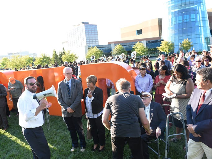 Community relations director Michael Manion, with megaphone,