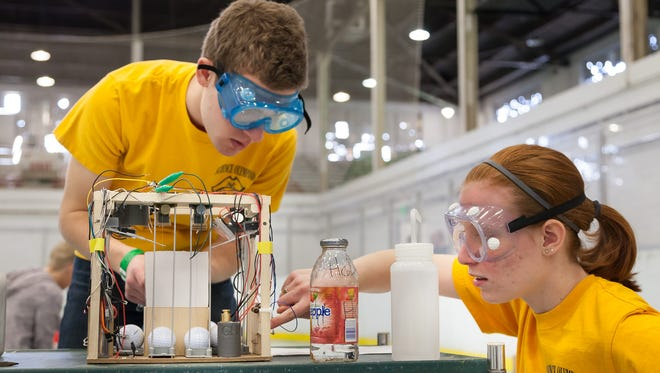 At the Michigan State Science Olympiad, students compete in both hands on and written challenges.