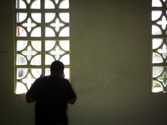 A student looks out a window at Escuela Superior JoseŽ Campeche in San Lorenzo, Puerto Rico.