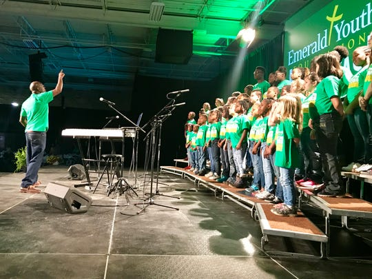 John Jackson directs children from the Emerald Youth