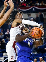 University of Memphis forward Raynere Thornton (right) is fouled by University of Alabama defender John Petty (left) during second half action at the Veterans Classic  in Annapolis, Md., Friday, November 10, 2017.