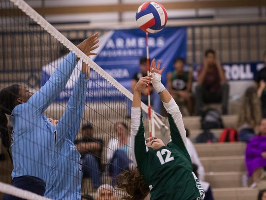 King's Vanessa Lugo hits this the ball over the net