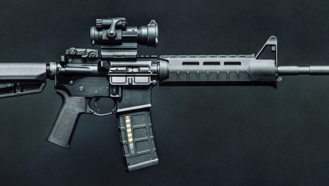 Semiautomatic AR-15 Type Rifle in 5.56mm with red dot optic.