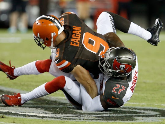 Cleveland Browns wide receiver Ed Eagan (9) is tackled by Tampa Bay Buccaneers cornerback Johnthan Banks (27) during the second half Sunday. Banks played at Mississippi State.