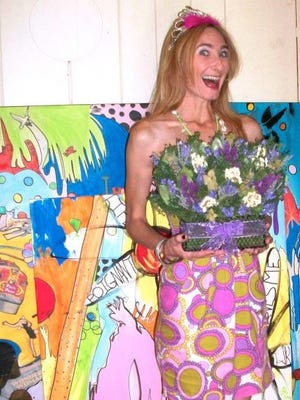 Tami-Lu Barry with some of her artwork.