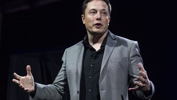 Tesla Motors CEO Elon Musk unveils the company's newest
