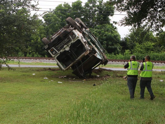 Video Trash Truck Overturns On Millhaven Road