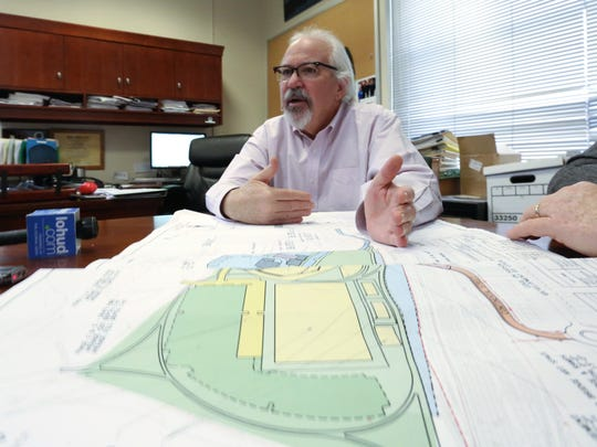 "Sleepy Hollow Mayor Ken Wray looks over plans for the village-owned ""east parcel"" portion of the former GM assembly plant along the Hudson. Dubbed ""The Common,"" the area could one day be accessed by a new car bridge over the Metro-North tracks, linking to Continental Street, the mayor said."