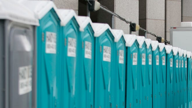 Portable toilets lined up.