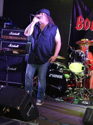 Dan Mayer sings with Bonfire. He was killed in an industrial accident Thursday, December 1.
