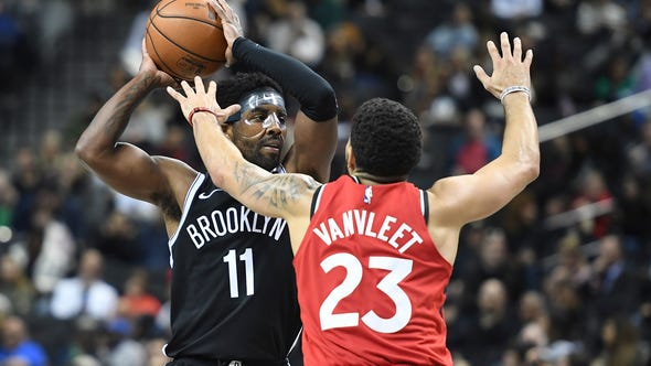 Brooklyn Nets guard Kyrie Irving (11) looks to pass as Toronto Raptors guard Fred VanVleet (23) defends during the third quarter of a preseason NBA basketball game Friday, Oct. 18, 2019, in New York. (AP Photo/Sarah Stier)