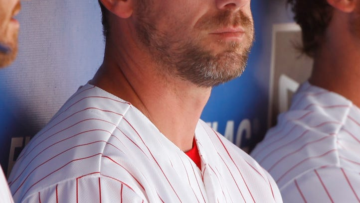 Phillies starting pitcher Cliff Lee sits in the dugout