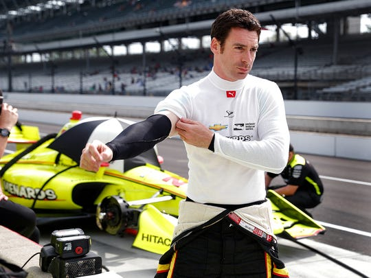 Team Penske driver Simon Pagenaud prepares himself for the Verizon IndyCar qualifications for the IndyCar Grand Prix at the Indianapolis Motor Speedway on Friday, May 11, 2018.