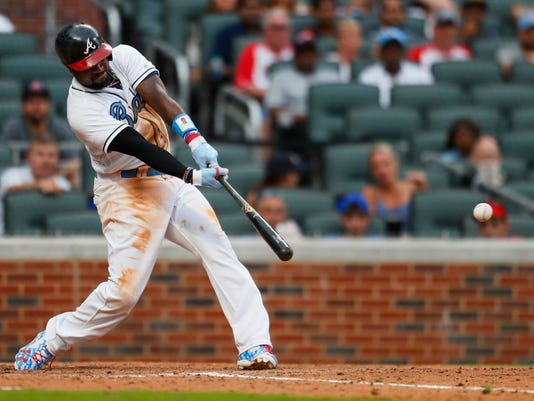 Atlanta Braves Brandon Phillips hits a game-ending single in the tenth inning of a baseball game against the Miami Marlins, Saturday, June 17, 2017, in Atlanta. (AP Photo/Todd Kirkland)