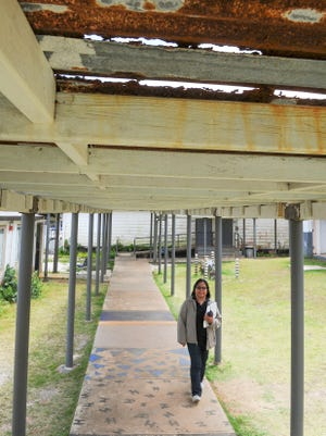 This file photo shows a wood-and-tin canopy near the science classes at Simon Sanchez High School .