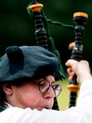 A bagpipe competitor competes at the Smoky Mountain