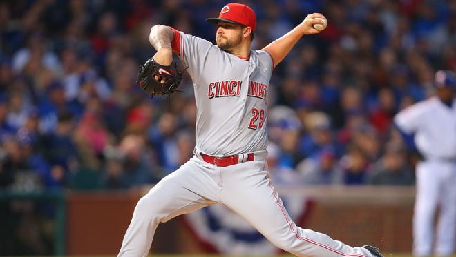 Cincinnati Reds starting pitcher Brandon Finnegan (29) delivers a pitch during the second inning against the Chicago Cubs at Wrigley Field on Monday.