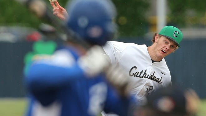 Cathedral's Ashe Russell fires a pitch to a Bishop Chatard batter during their game on Wednesday, May 21, 2015. Russell is considered a potential first-round pick in the major league baseball draft in June 2015.