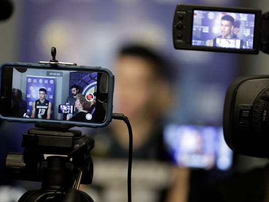 Cameras record an interview with Missouri's Michael Porter Jr. during the Southeastern Conference men's NCAA college basketball media day Wednesday, Oct. 18, 2017, in Nashville, Tenn. (AP Photo/Mark Humphrey)