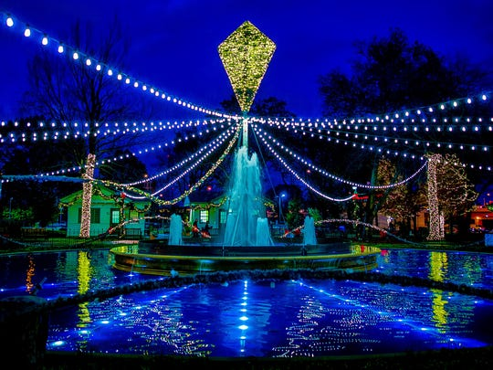 The marble fountain in Franklin Square is decorated with lights during the Electrical Spectacle in Philadelphia.